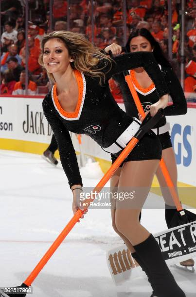 Krista Allysse Cipollone of the Philadelphia Flyers ice girls cleans the ice during a timeout against the Washington Capitals on October 14 2017 at...