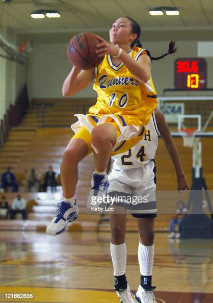 Krista Arase of Cal State Bakersfield drives to the basket during CCAA women's basketball game against Cal State Dominguez Hills in Carson California...