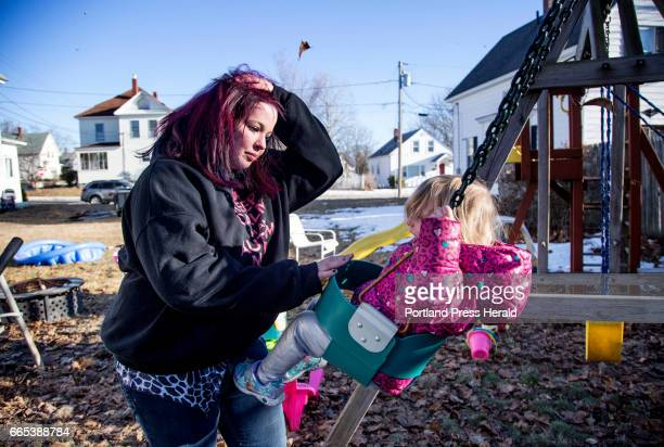 Krista Benson a recovering heroin addict pushes her daughter Temperance Pontes on a swing at their home in Sanford on Thursday March 2 2017 Krista is...