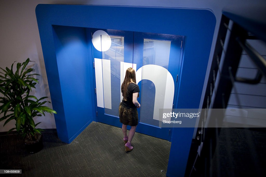 Krista Canfield, senior public relations manager for LinkedIn Corp., walks into an office at company headquarters in Mountain View, California, U.S., on Thursday, Jan. 27, 2011. LinkedIn Corp., the largest networking website for professionals, said it plans to raise as much as $175 million in an initial public offering. Photographer: David Paul Morris/Bloomberg via Getty Images