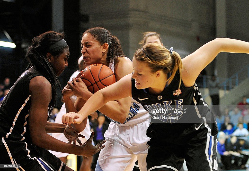 Krista Gross #21of the North Carolina Tar Heels takes a rebound away from Elizabeth Williams #1 and Tricia Liston #32 of the Duke Blue Devils during play at Carmichael Arena on February 3, 2013 in Chapel Hill, North Carolina. Duke won 84-63.