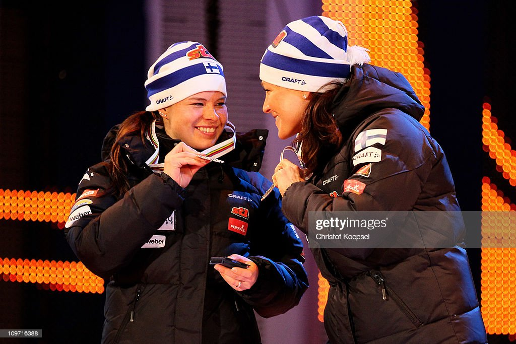 Krista Lahteenmaki and Aino Kaisa Saarinen of Finland pose with the bronze medals won in the Ladies Cross Country Team Sprint race during the FIS Nordic World Ski Championships at University Square on March 2, 2011 in Oslo, Norway.