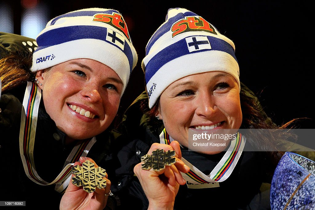 Krista Lahteenmaki and Aino Kaisa Saarinen of Finland pose with the silver medals won in the Ladies Cross Country Team Sprint race during the FIS Nordic World Ski Championships at University Square on March 2, 2011 in Oslo, Norway.