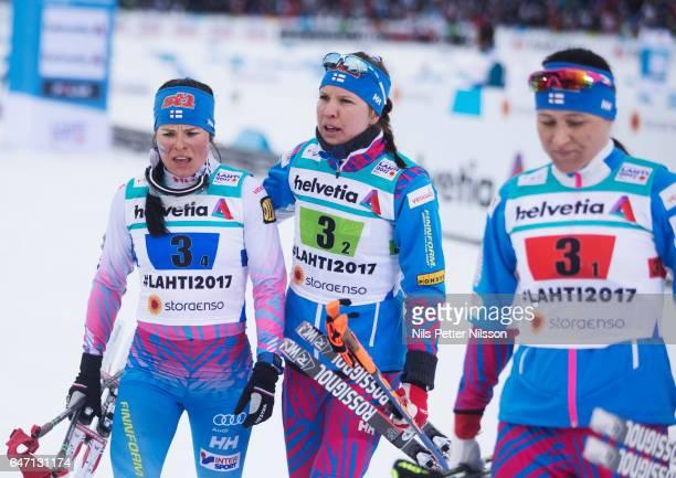 Krista Parmakoski Kerttu Niskanen and AinoKaisa Saarinen of Finland during the women's cross country relay during the FIS Nordic World Ski...