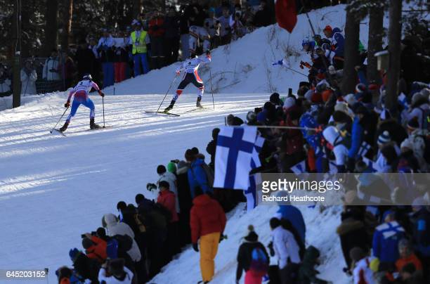 Krista Parmakoski of Finland and Marit Bjoergen of Norway compete in the Women's Cross Country Skiathlon during the FIS Nordic World Ski...