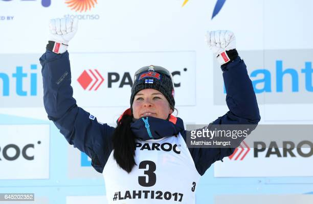 Krista Parmakoski of Finland celebrates her silver medal win during the flower ceromeny after the Women's Cross Country Skiathlon during the FIS...
