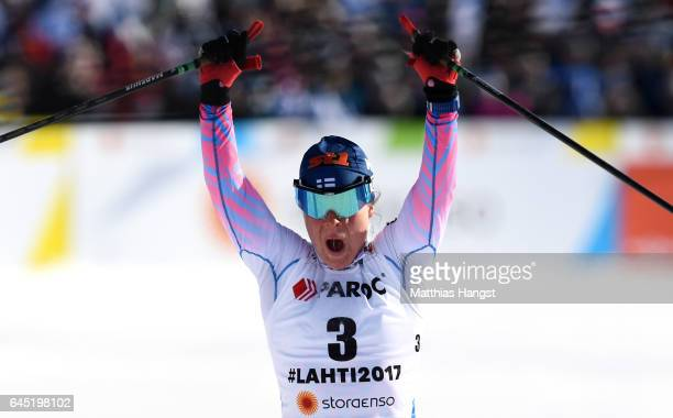 Krista Parmakoski of Finland celebrates winning a silver medal during the Women's Cross Country Skiathlon during the FIS Nordic World Ski...