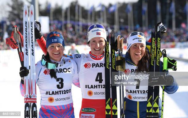 Krista Parmakoski of Finland Marit Bjoergen of Norway and Charlotte Kalla of Sweden pose after the Women's Cross Country Skiathlon during the FIS...