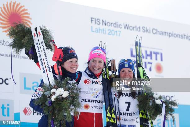 Krista Parmakoski of Finland Marit Bjorgen of Norway and Charlotte Kalla of Sweden during the cross country skiathlon during the FIS Nordic World Ski...