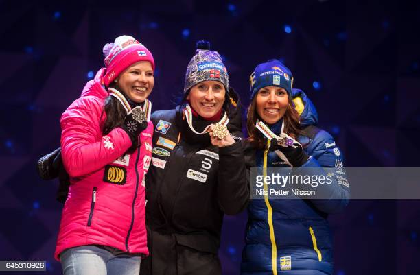 Krista Parmakoski of Finland Marit Bjorgen of Norway and Charlotte Kalla of Sweden shows their medals during the price ceremony after the cross...