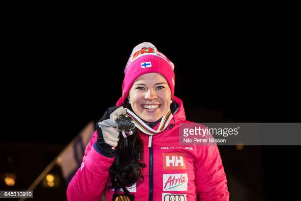 Krista Parmakoski of Finland shows her silver medal during the price ceremony after the cross country skiathlon in the FIS Nordic World Ski...