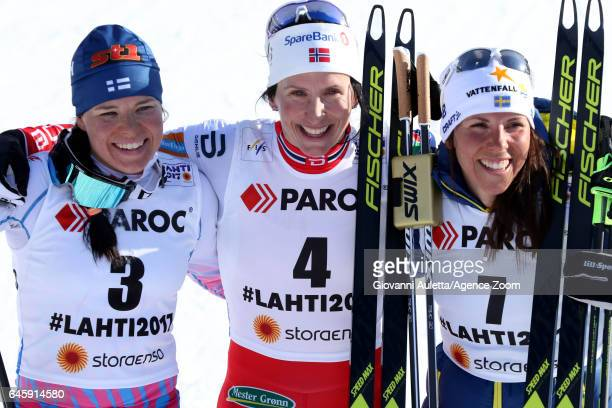 Krista Parmakoski of Finland wins the silver medal Marit Bjoergen of Norway wins the gold medal Charlotte Kalla of Sweden wins the bronze medal...