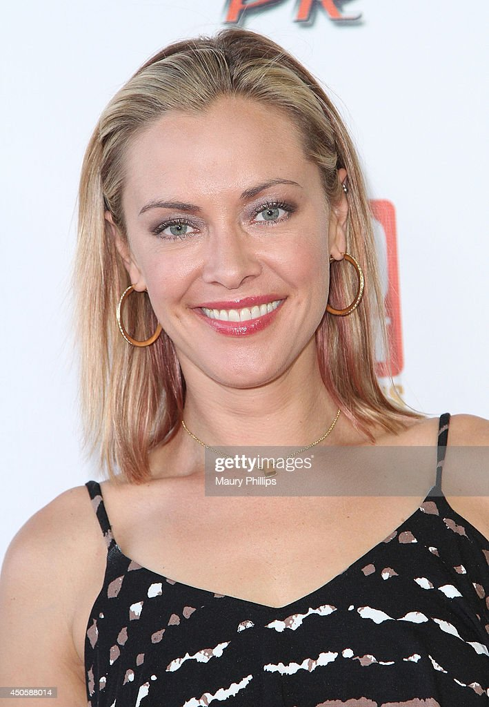Kristanna Loken arrives at Lorenzo Lamas' New Business Elite Helicopter launch party at the Van Nuys Airport on June 13, 2014 in Van Nuys, California.
