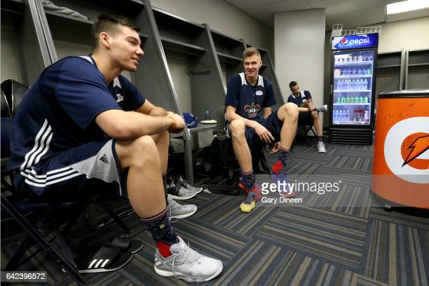 Kristaps Porzingas and Willy Hernangomez of the World Team share a smile in the locker room before the BBVA Rising Stars Challenge Practice as part...