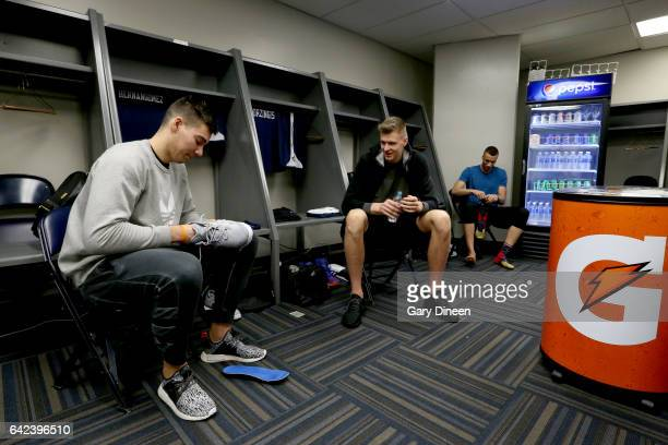 Kristaps Porzingas and Willy Hernangomez of the World Team talk in the locker room before the BBVA Rising Stars Challenge Practice as part of 2017...