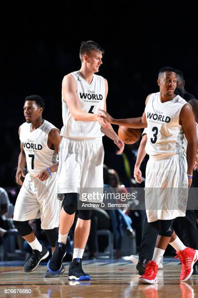 Kristaps Porzingis and CJ McCollum of Team World high five each other during the game against Team Africa in the 2017 Africa Game as part of the...
