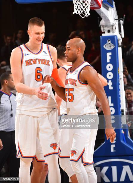 Kristaps Porzingis and Jarrett Jack of the New York Knicks gather after the win against the Atlanta Hawks at Madison Square Garden on December 10...