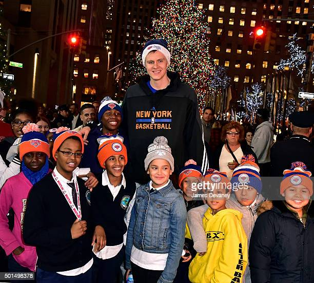 Kristaps Porzingis and kids from The Garden of Dreams Foundation visit the Rockefeller Center Christmas tree on December 15 2015 in New York City