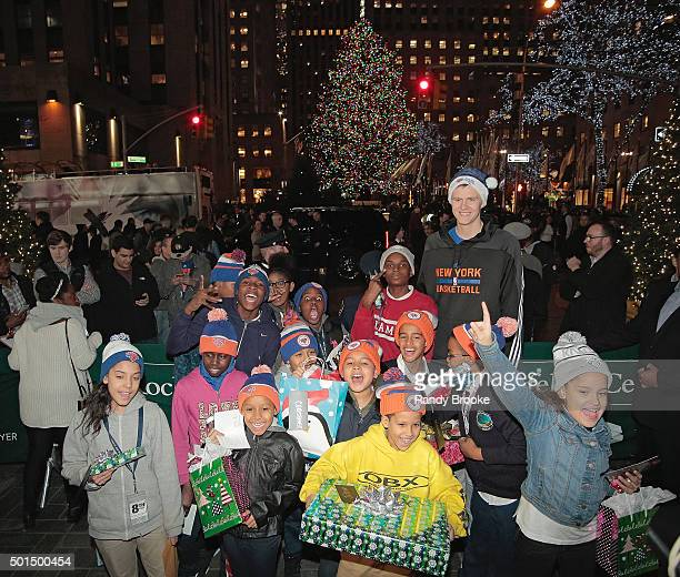 Kristaps Porzingis and kids from The Garden of Dreams Foundation visit the tree at Rockefeller Center on December 15 2015 in New York City