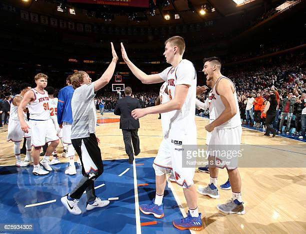 Kristaps Porzingis and Ron Baker of the New York Knicks high five after the game against the Charlotte Hornets at Madison Square Garden in New York...