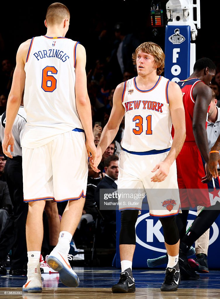 Kristaps Porzingis #6 and Ron Baker #31 of the New York Knicks react during a preseason game against the Washington Wizards on October 10, 2016 at Madison Square Garden in New York City, New York.