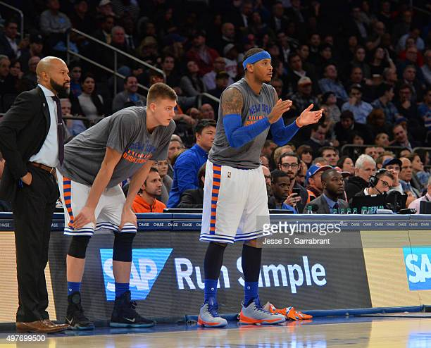 Kristaps Porzingis Carmelo Anthony and Head Coach Derek Fisher of the New York Knicks against the Charlotte Hornets at Madison Square Garden on...