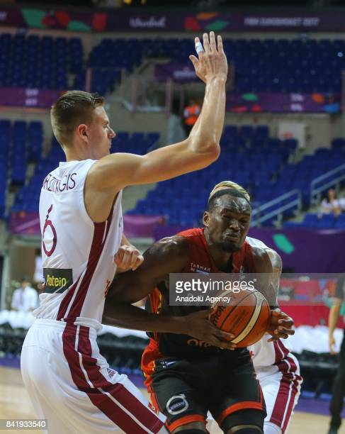 Kristaps Porzingis of Latvia in action against Jonathan Tabu of Belgium during the FIBA Eurobasket 2017 Group D Men's basketball match between Latvia...