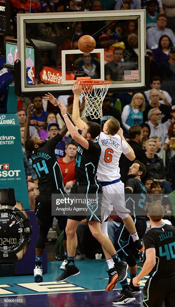 Kristaps Porzingis (R) of New York Knicks scores during the NBA match between New York Knicks vs Charlotte Hornets at the Spectrum arena in Charlotte, NC, USA on November 26, 2016.