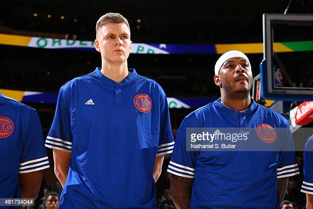 Kristaps Porzingis of the New York Knicks and Carmelo Anthony of the New York Knicks stand for the national anthem before a preseason game against...