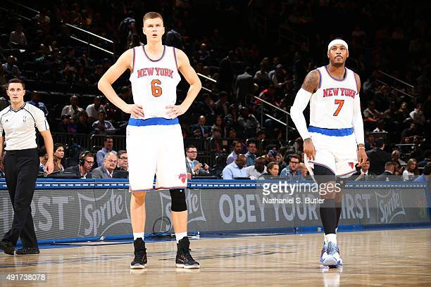 Kristaps Porzingis of the New York Knicks and Carmelo Anthony of the New York Knicks stand on the court against Paschoalotto/Bauru during a preseason...