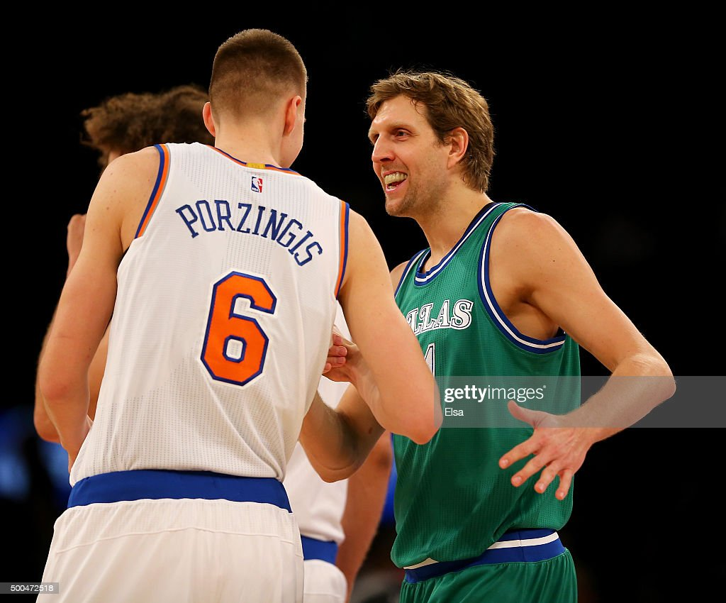 Kristaps Porzingis #6 of the New York Knicks and Dirk Nowitzki #41 of the Dallas Mavericks greet each other before the opening tipoff at Madison Square Garden on December 7, 2015 in New York City.