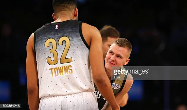 Kristaps Porzingis of the New York Knicks and World team prepares for the opening tip against KarlAnthony Towns of the Minnesota Timberwolves and the...