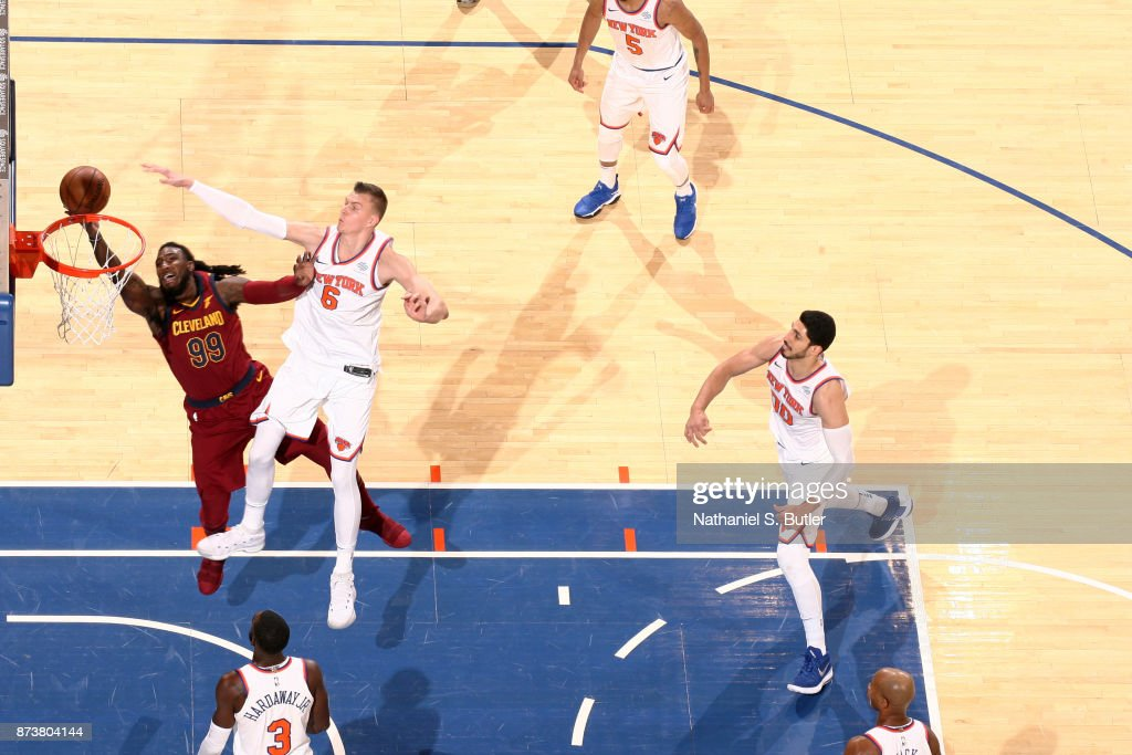 Kristaps Porzingis #6 of the New York Knicks attempts to block the shot by Jae Crowder #99 of the Cleveland Cavaliers on November 13, 2017 at Madison Square Garden in New York City, New York.