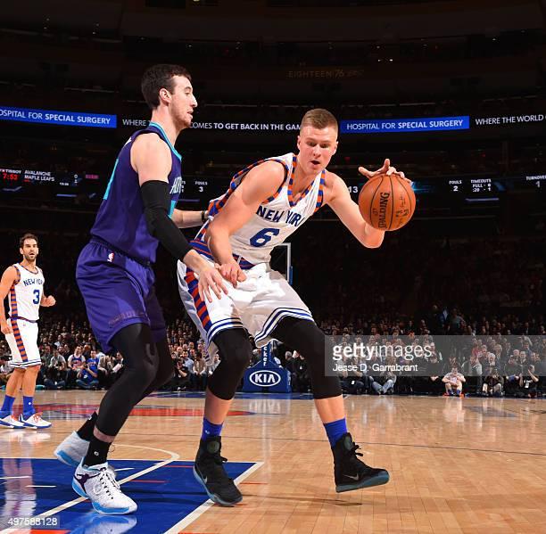 Kristaps Porzingis of the New York Knicks backs up to the basket against the Charlotte Hornets at Madison Square Garden on November 17 2015 in New...
