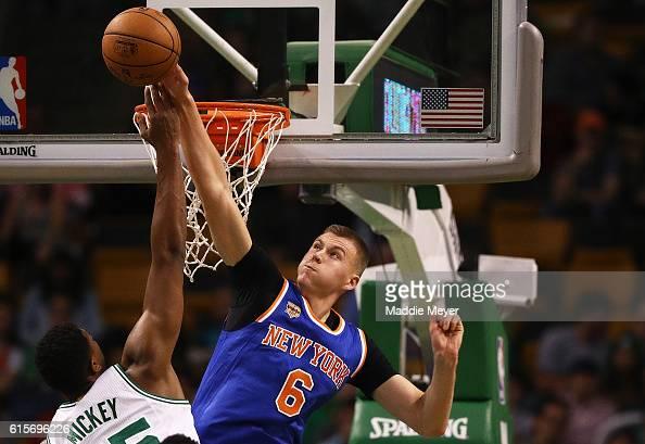 Kristaps Porzingis of the New York Knicks blocks a shot by Jordan Mickey of the Boston Celtics during the second quarter at TD Garden on October 17...