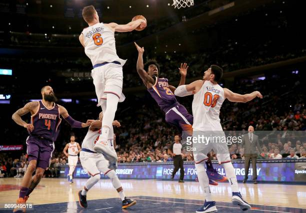 Kristaps Porzingis of the New York Knicks blocks a shot by Josh Jackson of the Phoenix Suns after Jackson stole the ball from Porzingis in the...