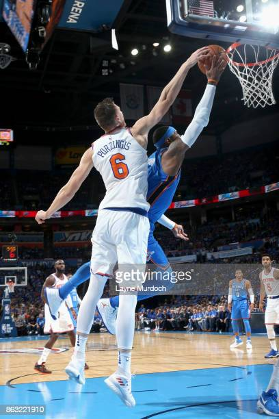 Kristaps Porzingis of the New York Knicks blocks the shot against Carmelo Anthony of the Oklahoma City Thunder on October 19 2017 at Chesapeake...