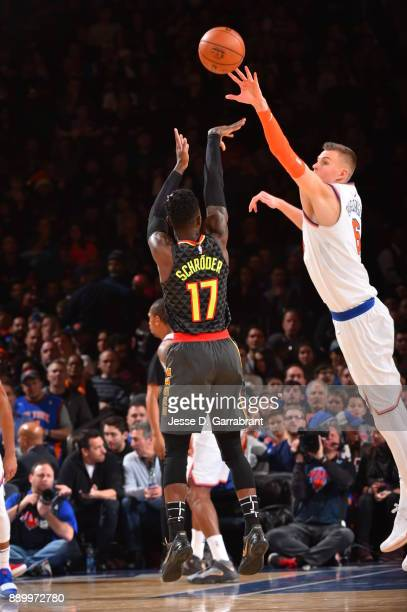 Kristaps Porzingis of the New York Knicks blocks the shot against the Atlanta Hawks at Madison Square Garden on December 10 2017 in New York New York...