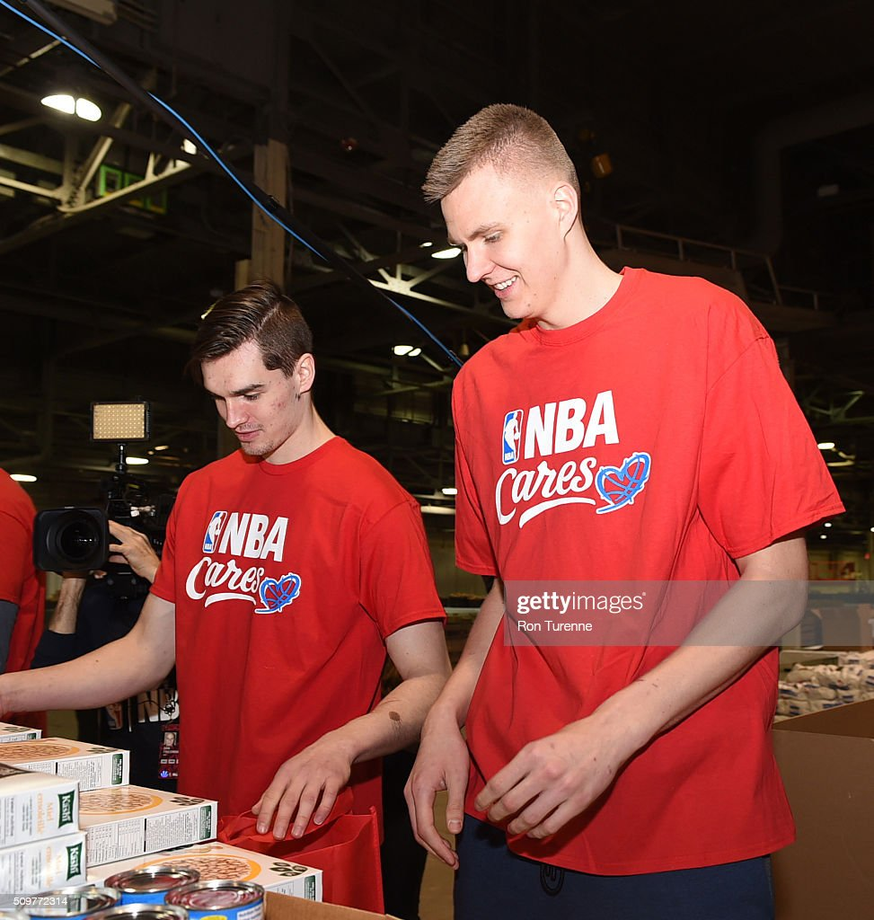 Kristaps Porzingis of the New York Knicks boxes food during the NBA Cares All-Star Day of Service as part of 2016 All-Star Weekend at NBA Centre Court of the Enercare Centre on February 12, 2016 in Toronto, Ontario, Canada.