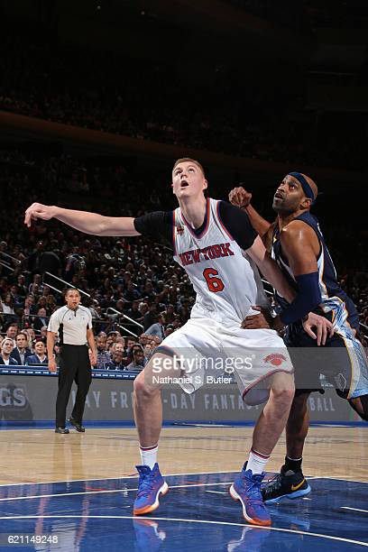 Kristaps Porzingis of the New York Knicks boxes out Vince Carter of the Memphis Grizzlies on October 29 2016 at Madison Square Garden in New York...
