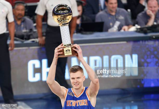Kristaps Porzingis of the New York Knicks celebrates after winning the 2017 Taco Bell Skills Challenge at Smoothie King Center on February 18 2017 in...