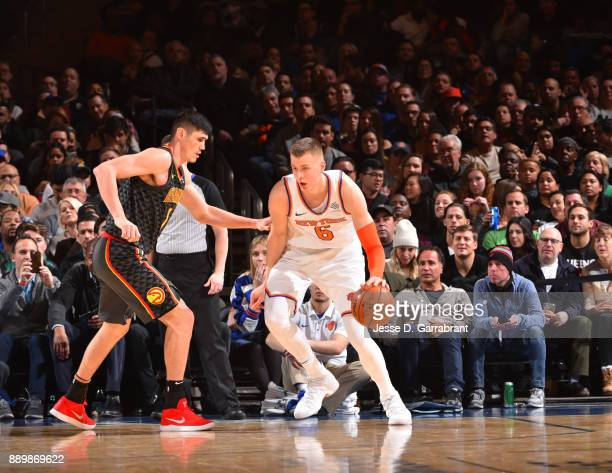 Kristaps Porzingis of the New York Knicks controls the ball down low against the Atlanta Hawks at Madison Square Garden on December 10 2017 in New...