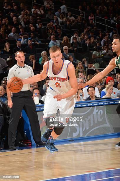 Kristaps Porzingis of the New York Knicks drives baseline against the Milwaukee Bucks at Madison Square Garden on November 6 2015 in New YorkNew York...