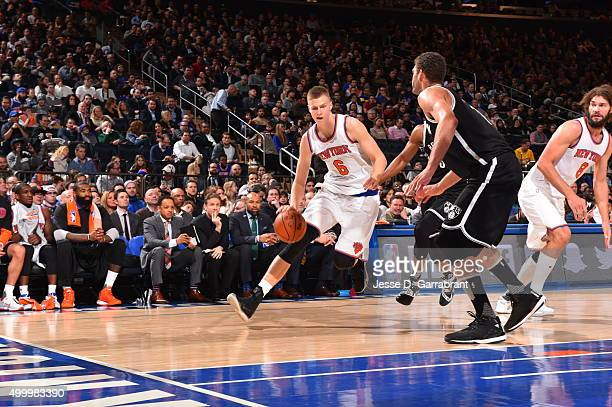 Kristaps Porzingis of the New York Knicks drives baseline against the Brooklyn Nets at Madison Square Garden on December 4 2015 in New YorkNew York...