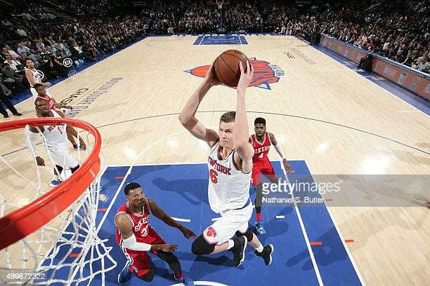 Kristaps Porzingis of the New York Knicks drives to the basket Philadelphia 76ers on December 2 2015 at Madison Square Garden in New York City New...