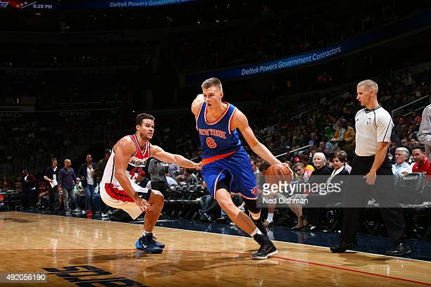 Kristaps Porzingis of the New York Knicks drives to the basket against Kris Humphries of the Washington Wizards during a preseason game on October 9...