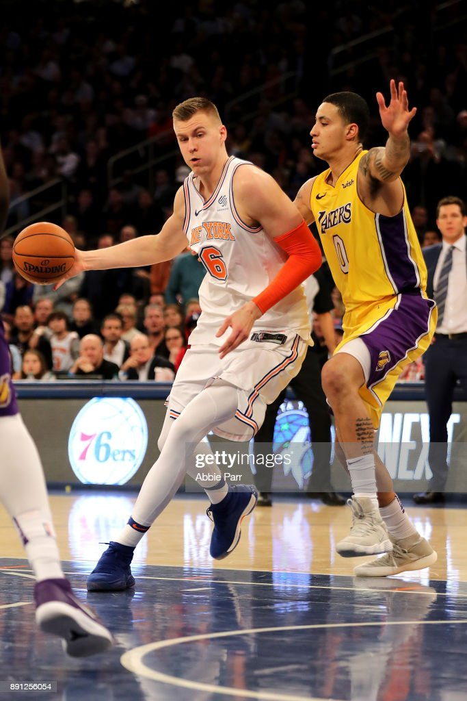 Kristaps Porzingis #6 of the New York Knicks drives to the basket against Kyle Kuzma #0 of the Los Angeles Lakers in overtime during their game at Madison Square Garden on December 12, 2017 in New York City.