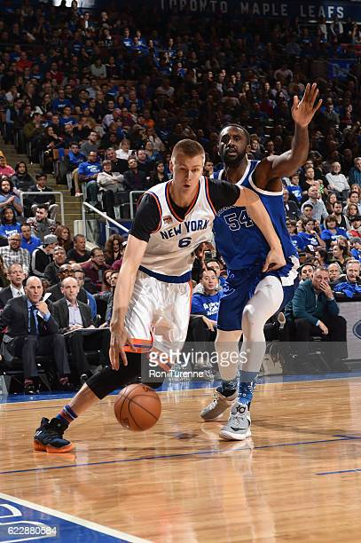 Kristaps Porzingis of the New York Knicks drives to the basket against Patrick Patterson of the Toronto Raptors during a game on November 12 2016 at...