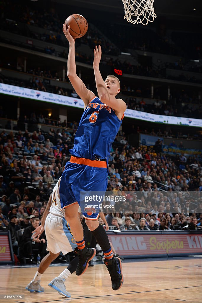 Kristaps Porzingis #6 of the New York Knicks drives to the basket against the Denver Nuggets on March 8, 2016 at the Pepsi Center in Denver, Colorado.
