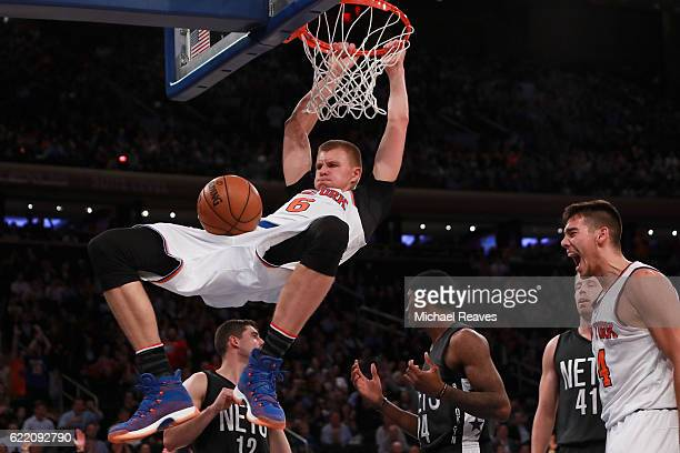 Kristaps Porzingis of the New York Knicks dunks against the Brooklyn Nets during the second half at Madison Square Garden on November 9 2016 in New...